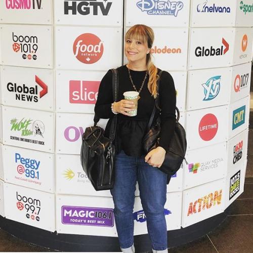 Niki in front of media hub